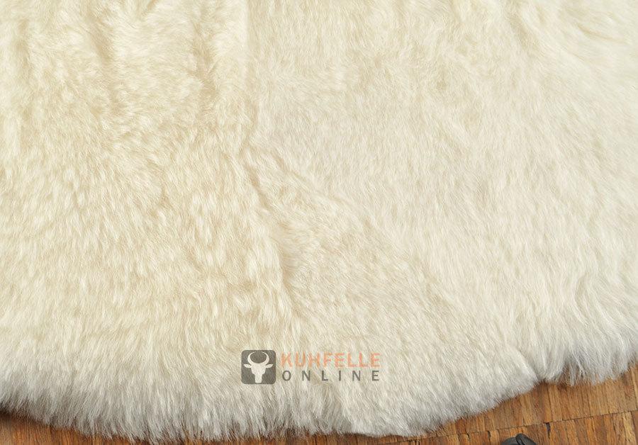 island lammfell teppich naturwei 180 x 115 cm kurzhaarig. Black Bedroom Furniture Sets. Home Design Ideas